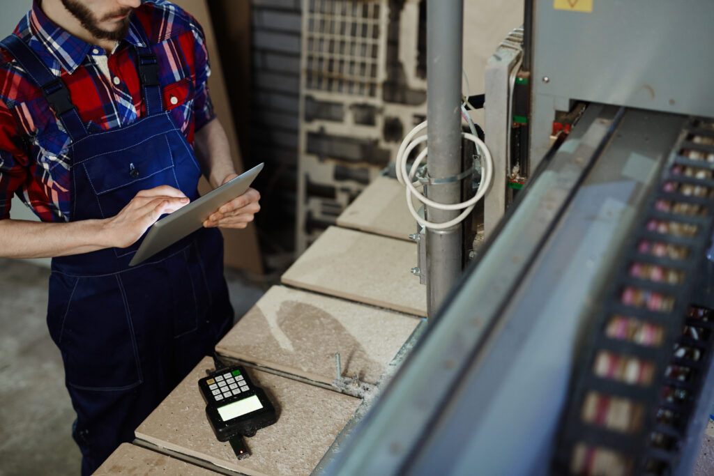 worker using tablet for maintenance and inspection record-keeping